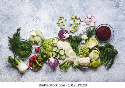Plant based raw food vegan food cooking background. Flat-lay of fresh vegetables, greens, smoothie bowl superfoods o top view, copy space. Clean eating, alkaline diet, vegetarian concept