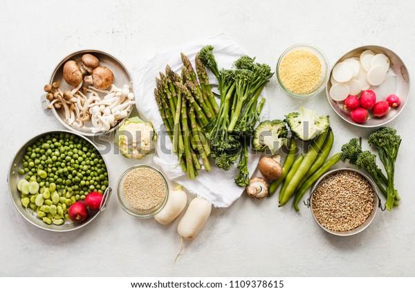 Plant based raw food vegan quinoa bulgur amarant grains fresh vegetables