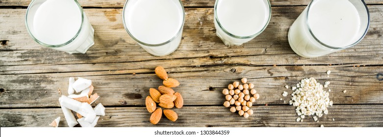plant based vegan food and drink, Non-dairy milk and cheese tofu - from almond, nuts, soy beans, oats and coconut, wooden background copy space banner