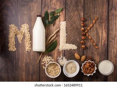Plant based vegan milk, letters made of various  ingredients for plant milk