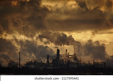 The plant emits smoke and smog from the pipes at sunset, pollutants enter the atmosphere. Environmental disaster. Harmful emissions into. Exhaust gases. Metallurgical industry against the sky.
