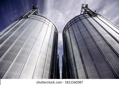 Plant for processing and silos for drying cleaning and storage of agricultural products, flour, cereals and grain. Silver tanks close-up.