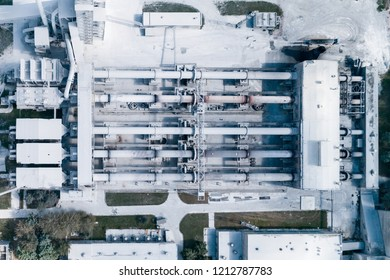 Plant for the production of cement, clinker and gypsum. Tubular rotary kilns. Aerial photography, view vertically down.