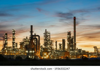 Oil​ refinery​ and​  plant and tower column of Petrochemistry industry in oil​ and​ gas​ ​industrial with​ cloud​ orange​ ​sky the sunrise​ background​