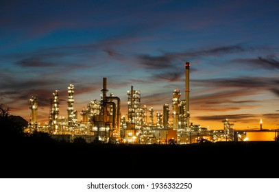 Oil refinery and  plant and tower column of Petrochemistry industry in oil and gas industrial with cloud orange sky the sunrise background