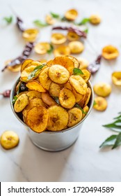 Plantain chips on a tin