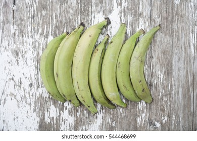 Plantains on a wooden background