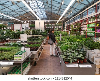 Plantasjen Frowers shop, Arendal Norway , October 19 -2018 : unidentified Thai woman buying plant in the green shouse at Arendal city, Norway.