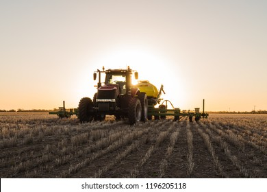 Planting Sorghum during sunset on a farm in the Australian outback.