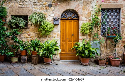 Plants surround doorway in Tuscany, Italy