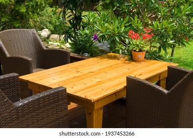 Plants, tables and chairs on the garden terrace