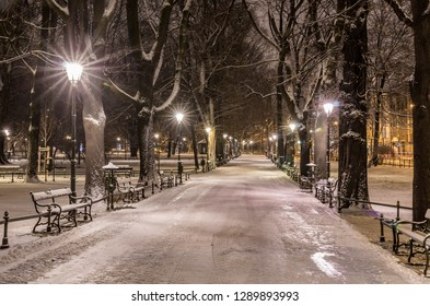 Planty park in the snow, winter night, Krakow, Poland