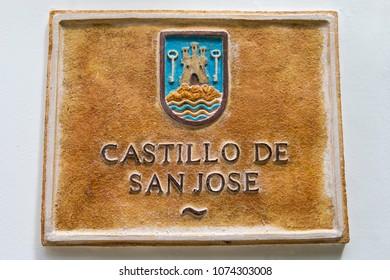 A plaque at the historic Castillo de San Jose in Guadalest, Spain.
