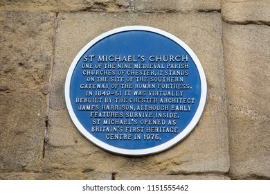 A plaque on the exterior of St. Michaels Church, detailing the history of the building, in the historic city of Chester, UK.