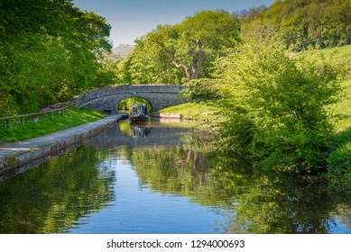 Plas Ifab bridge No 40W with an approaching narrowboat on the Llangollen Canal between Trevor and LLangollen in Wales, UK