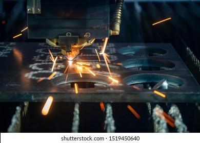 The plasma argon gas cutting machine control by CNC program cutting the thick metal plate. The raw material prepare process by CNC gas cutting machine with the sparking light.