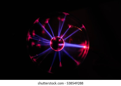 Plasma ball lamp energy, hand touching glowing glass sphere concept for power, electricity, science and physics