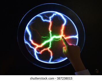 Plasma ball, if touched multicolor flashes appear