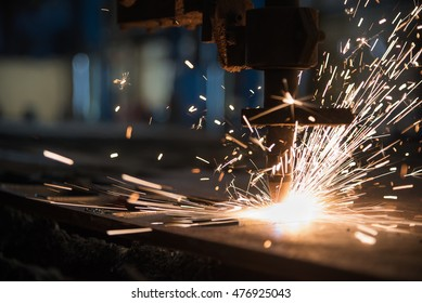 Plasma cutting metalwork industry machine with sparks in factory
