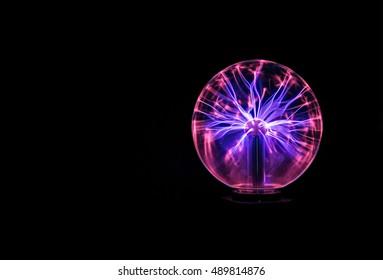 A plasma globe lit up against a black background
