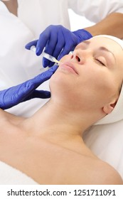 Plasma injection. A rejuvenating treatment. A patient in a cosmetic clinic, a beautician performs an injection procedure.