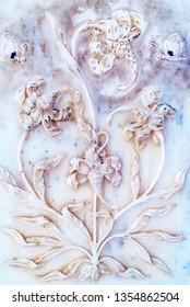 Plaster background decorative white floral pattern close