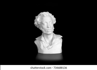 A plaster bust of Alexander Sergeyevich Pushkin isolated on black