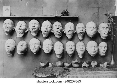 Plaster casts of WW1 soldiers' mutilated faces in sculptor Anna Ladd studio. 1918. Below them are plaster molds of 'restored' faces Ladd modeled. France, 1918.