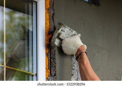 Plaster facade for wall decoration. Applying plastering mortar to the outer wall.