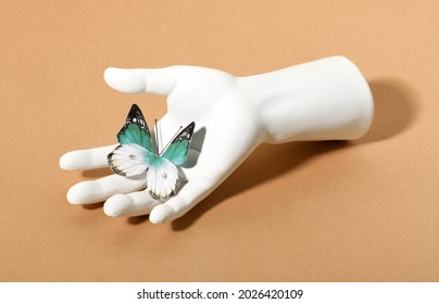 Plaster femele hand with butterfy