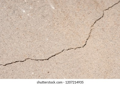 Plaster floor with cracks. Building requiring repair closeup.