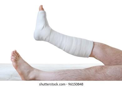 Plaster on leg. On white background.