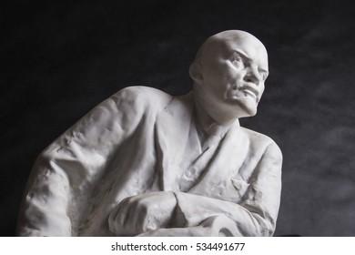 plaster sculpture of Lenin on a black background