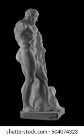 plaster statue of Hercules, naked man on isolated black background