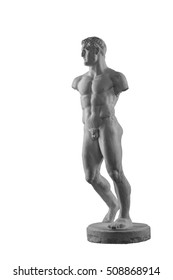 plaster statue of a naked male athlete isolated on a black background