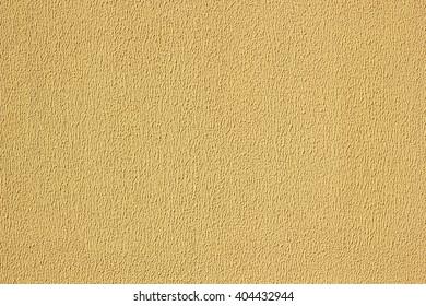 Plaster texture wall. Exterior beige stucco.