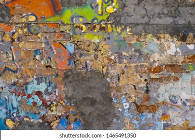 Plastered Brick Wall With Drops Or Flows And Paint Sprays. Multi-Colored Paint Dripping Down On Dirty Surface.