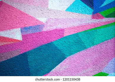 plastered bright wall, decorated with geometric patterns in different colors, background, texture
