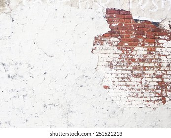 plastered wall with exposed brick wall