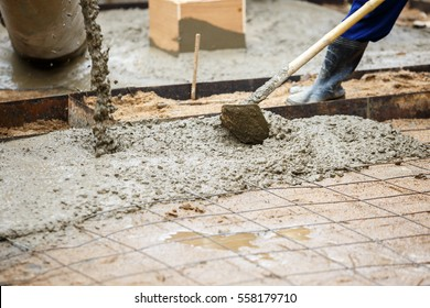 plasterer concrete worker at floor construction