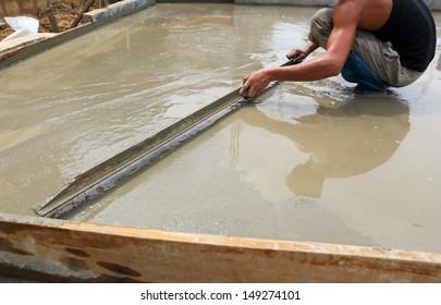 plasterer concrete worker at floor work
