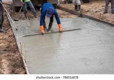 plasterer concrete worker at floor work build a road