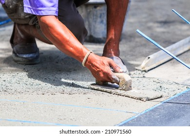 plasterer concrete worker smooth the cement