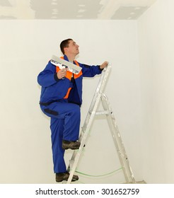 Plasterer with ladder in the room