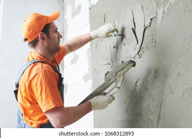 Plasterer putting plaster on wall. slow motion