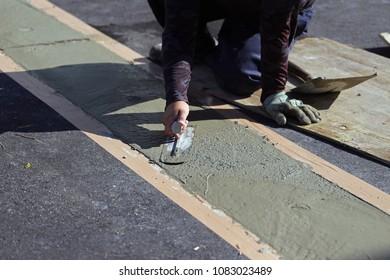 Plasterer  smooth mortar.