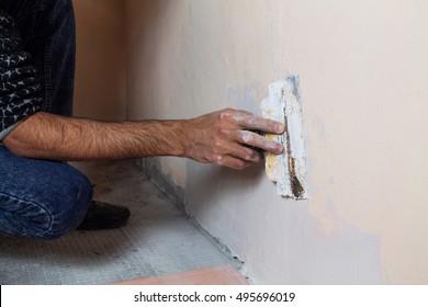 Plasterer working on room