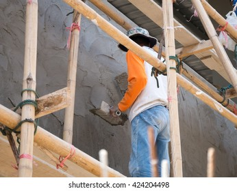 Plastering plaster building wall.