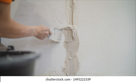 Plastering the wall. Hands Plasterer at work. Application of the plaster on the wall. textured plaster
