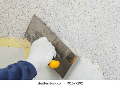 Plastering of walls decorative mineral plaster with a spatula